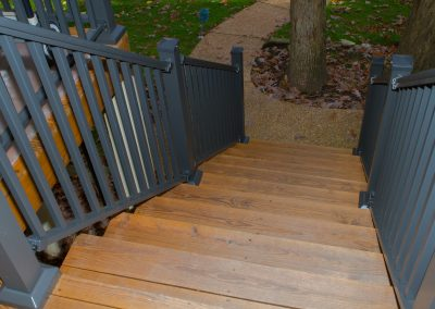 Sq Baluster Railing - Bronze w- Low Profile Post Base Cover on stairs